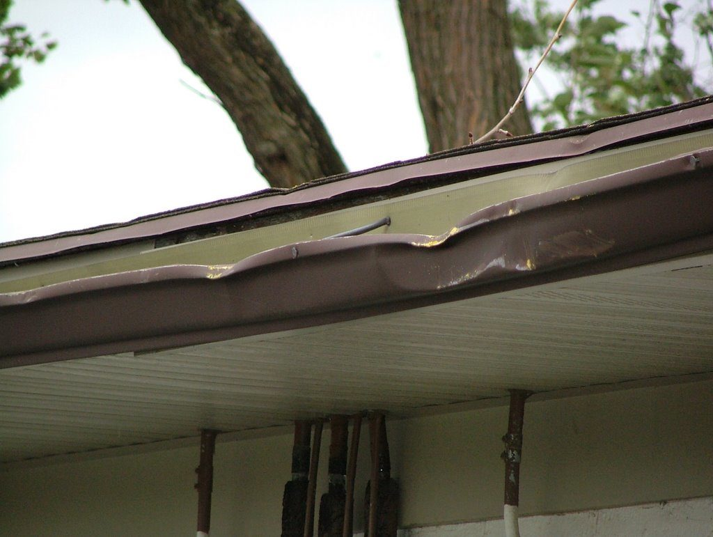 Gutter damage from big branch.