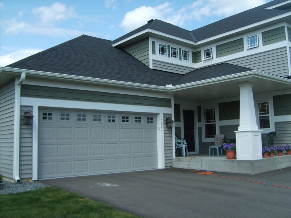 beautiful home with gutter system installed