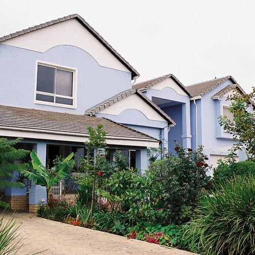 light_blue_coloured_double_storey_home_with_a_grey_roof