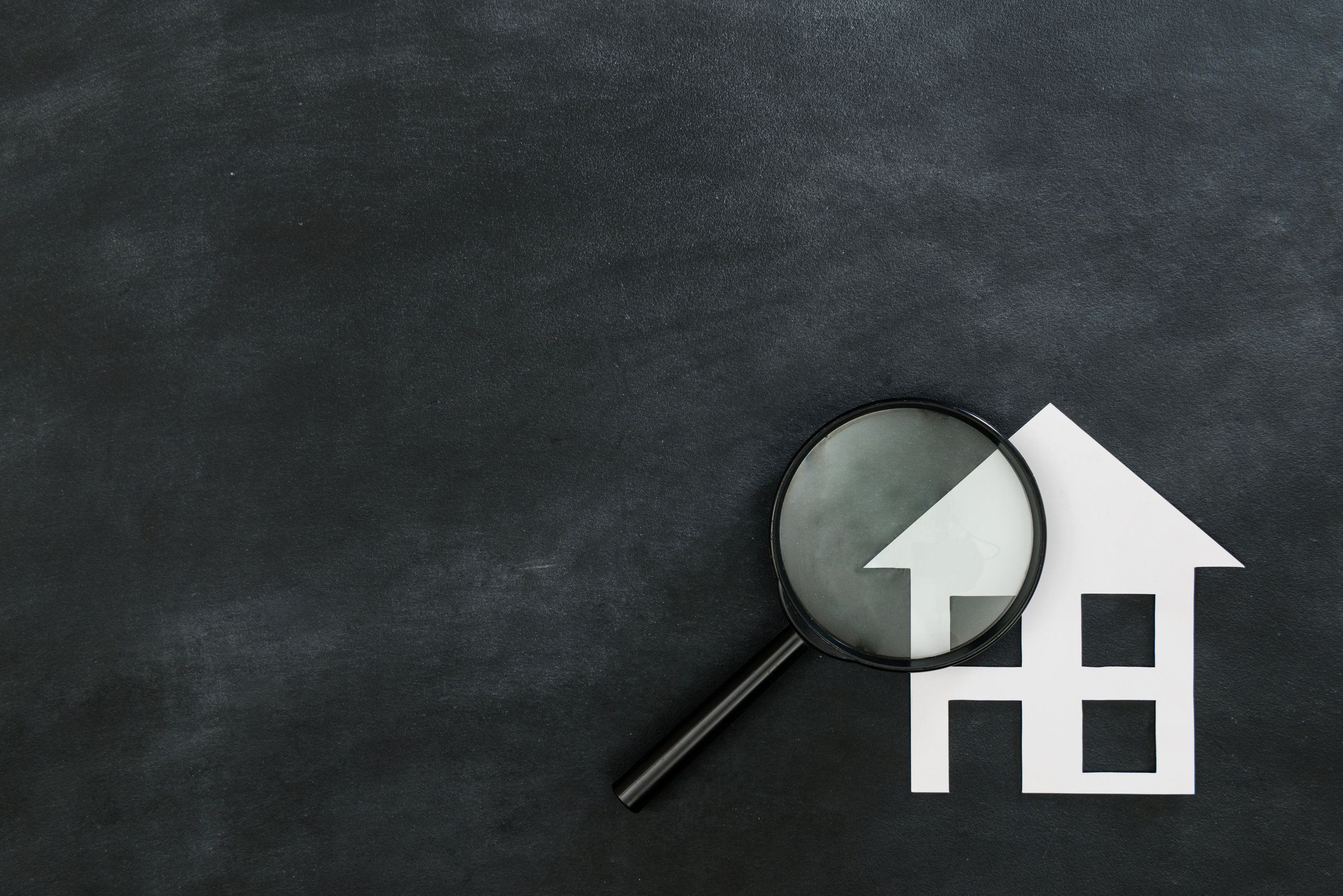 magnifier searching house isolated on chalkboard